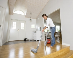 woman is cleaning the floor